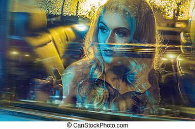 Attractive blond lady driving an elegant car