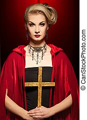 Attractive blond lady with a golden cross