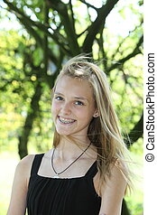 Attractive blond teenager with a lovely smile