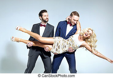 Attractive blond woman being carried by smart guys