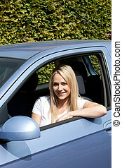 Attractive blond woman driver