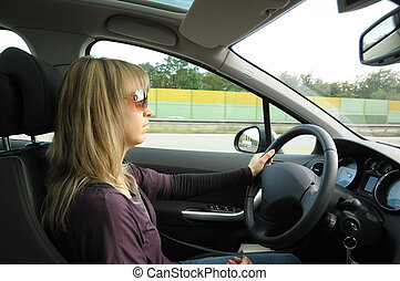 Attractive blond woman driving a car