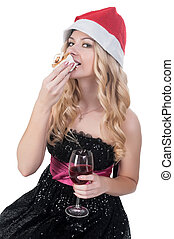 Attractive blond woman eating cake