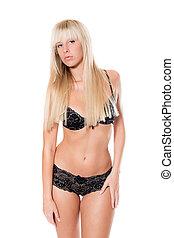 Attractive blond woman in beautiful black underwear