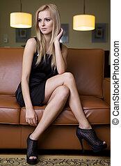 blond woman in black dress