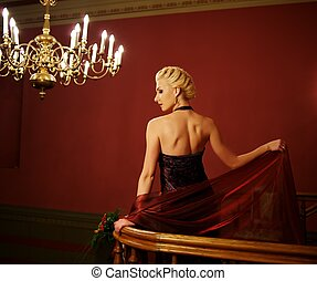 Attractive blond woman in evening dress