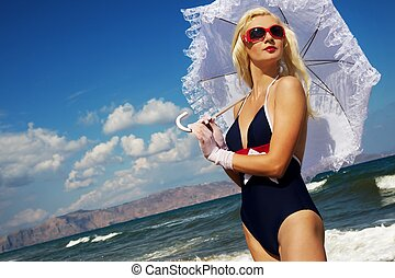 Attractive blond woman in the sea