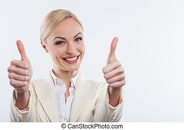 Attractive blond woman is evincing positive emotions