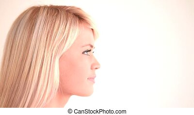 Attractive blond woman looking into