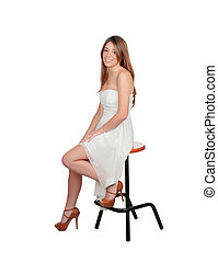 Attractive blond woman sitting on a stool