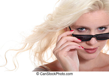 Attractive blond woman wearing sunglasses in studio