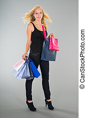 attractive blond woman with shopping bags