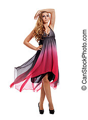 attractive blond young woman in pink dress isolated