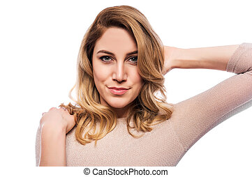 Attractive blond young woman. Portrait of a beautiful woman on a white background.