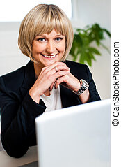 Attractive blonde business executive posing