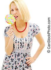 Attractive blonde licking lollipop