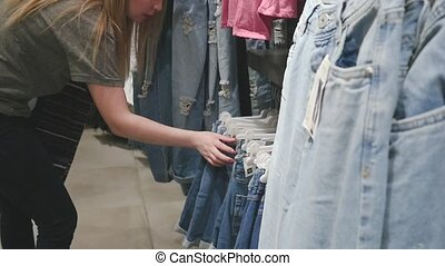blonde shopping at a women's clothing store
