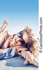 Attractive blonde taking a sunbath