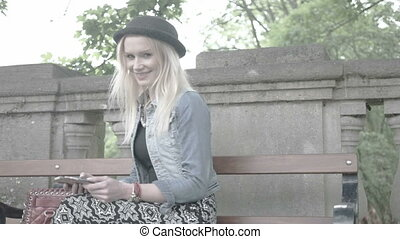 attractive blonde texting sitting