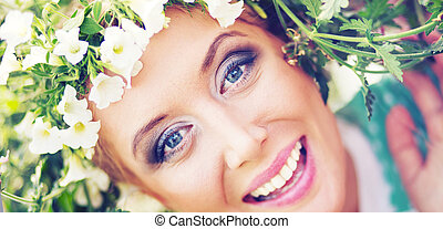 Attractive blonde with colorful wreath on the head