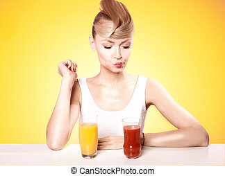 Attractive blonde woman with fruit juice.