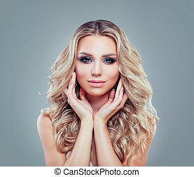 Attractive blonde woman with healthy skin, wavy hair and makeup, fashion portrait