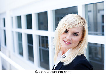 Attractive blonde woman with window
