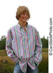 Attractive boy - Attractive young boy outdoors in striped ...