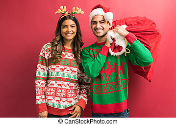 Attractive Boyfriend And Girlfriend With Christmas Presents