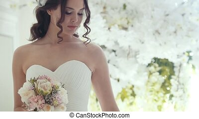 Attractive bride in wedding dress with professional make-up