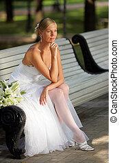 Attractive bride looking pensive