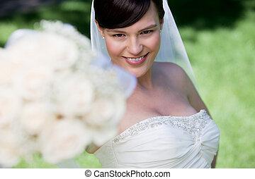 Bride Showing Off Her Flower Bouquet