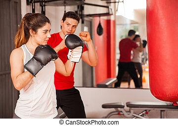 Attractive brunette boxing at the gym