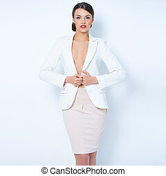 Attractive brunette business woman wearing jacket