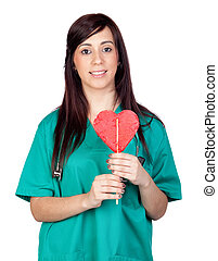 Attractive brunette doctor with a lollipop