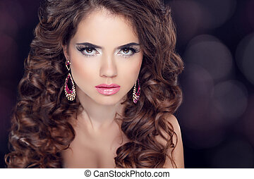 Attractive brunette girl model with long wavy hair styling, make
