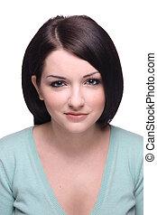 Attractive brunette girl smiling on white background