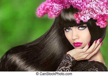 Attractive Brunette Girl with Flowers Long Hair. Healthy Black H
