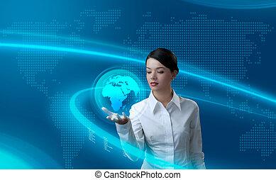 Attractive brunette holding virtual globe