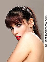 Attractive brunette looking over her shoulder