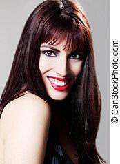 Attractive brunette model smiling