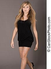 Attractive brunette model walking