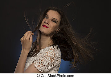 Attractive brunette model with magnificent hair at studio