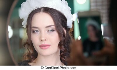 Attractive brunette model with wedding hairstyle and professional makeup