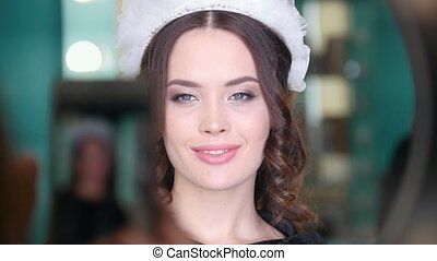 Attractive brunette model with wedding hairstyle and...