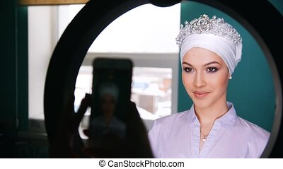 Attractive brunette model with wedding turban -...
