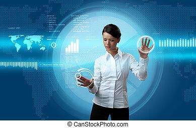 Attractive brunette navigating futuristic interface -...