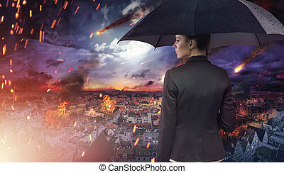 Attractive brunette staring at the natural disaster -...