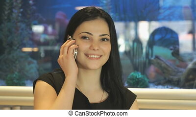 Attractive brunette talking on a mobile phone