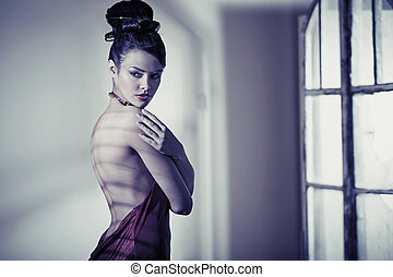 Attractive brunette wearing stylish gown - Attractive...